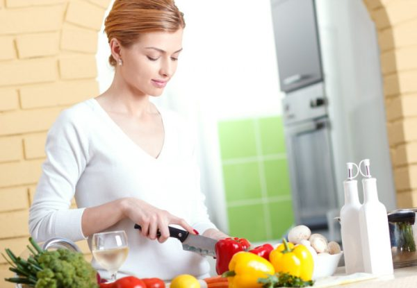 Lady cutting vegetables