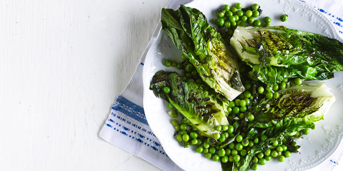 Griddled lettuce and peas on a plate
